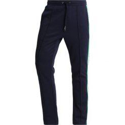 Calvin Klein Jeans SIDE STRIPE TRACK PANTS Spodnie treningowe dark blue. Niebieskie jeansy męskie Calvin Klein Jeans. Za 549,00 zł.