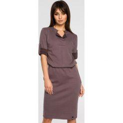 Sukienka sportowa podwijane rękawy bee-056. Niebieskie sukienki balowe marki SaF, na co dzień, xl, z żakardem, z asymetrycznym kołnierzem, dopasowane. Za 139,90 zł.