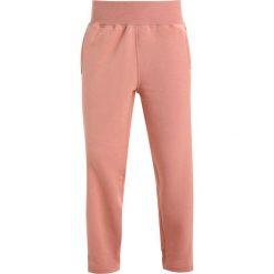 Bryczesy damskie: adidas by Stella McCartney Spodnie treningowe cinnamon blush