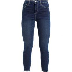 Topshop CONTRAST JAMIE Jeans Skinny Fit indigo. Niebieskie rurki damskie Topshop. Za 229,00 zł.