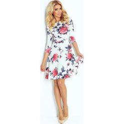 Paulina Rozkloszowana sukienka z rękawkiem. Szare sukienki hiszpanki numoco, s, w kwiaty, rozkloszowane. Za 91,02 zł.