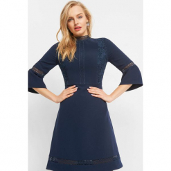Trapezowa sukienka z koronką. Czarne sukienki dzianinowe marki Orsay, xs, z dekoltem na plecach. Za 139,99 zł.