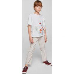 Mango Kids - Top dziecięcy Sabira 110-164 cm. Szare bluzki dziewczęce bawełniane Mango Kids, z aplikacjami, z okrągłym kołnierzem. Za 59,90 zł.