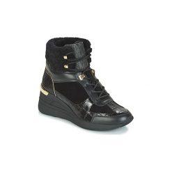 Śniegowce MICHAEL Michael Kors  SCOUT BOOTIE. Czarne buty zimowe damskie marki MICHAEL Michael Kors, z gumy, przed kolano, na wysokim obcasie. Za 1099,00 zł.