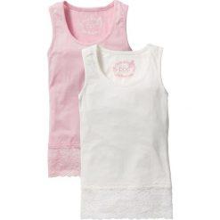 Top z koronkową wstawką (2 sztuki) bonprix pudrowy jasnoróżowy + biel wełny. Białe bluzki dziewczęce marki FOUGANZA, z bawełny. Za 49,98 zł.