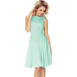 98-8 sukienka koło - dekolt łódka - lacosta mięta. Zielone sukienki na komunię marki numoco, l, z dekoltem w łódkę, rozkloszowane. Za 89,00 zł.