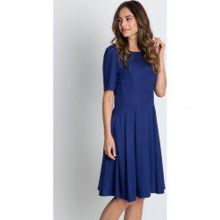 Sukienki: Niebieska rozkloszowana sukienka z krótkim rękawem BIALCON