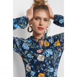 Koszulka w kwiaty. Brązowe bluzki wizytowe marki Orsay, s, z dzianiny. Za 69,99 zł.