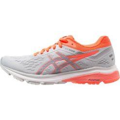 ASICS GT1000  Obuwie do biegania Stabilność mid grey/flash coral. Czarne buty do biegania damskie marki Asics. Za 509,00 zł.
