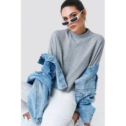 NA-KD Bluza nietoperz z surowym brzegiem - Grey. Szare długie bluzy damskie marki NA-KD, z bawełny, z podwyższonym stanem. Za 141,95 zł.