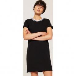 Sportowa sukienka z napisem - Czarny. Czarne sukienki sportowe marki House, l, z napisami, sportowe. Za 69,99 zł.