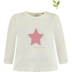 Koszulka w kolorze białym. Białe bluzki dziewczęce bawełniane bellybutton, z nadrukiem, z okrągłym kołnierzem, z długim rękawem. W wyprzedaży za 32,95 zł.