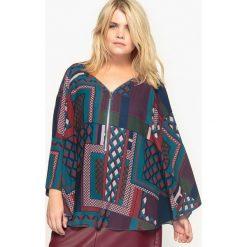 Bluzki asymetryczne: Wzorzysta bluzka peleryna