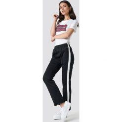 Calvin Klein Spodnie Side Stripe Track - Black. Czarne bryczesy damskie marki Calvin Klein. Za 526,95 zł.