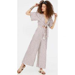 Kombinezony damskie: Kombinezon z długimi spodniami i węzłem