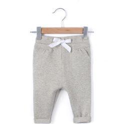 Spodnie z moltonu z kokardką 1 miesiąc - 3 lata. Szare spodnie dresowe dziewczęce La Redoute Collections, z bawełny. Za 52,88 zł.
