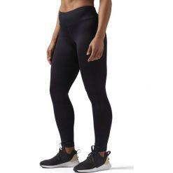 Legginsy sportowe. Czarne legginsy sportowe damskie marki Reebok, l, z elastanu, z standardowym stanem. Za 201,56 zł.