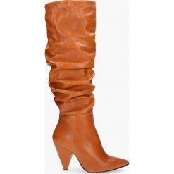 Kozak brązowy Suri. Brązowe buty zimowe damskie Badura. Za 559,99 zł.