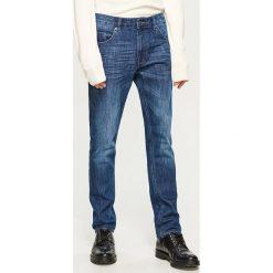 Jeansy slim fit Thermolite® - Granatowy. Niebieskie jeansy męskie relaxed fit marki House. Za 169,99 zł.