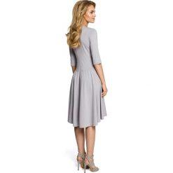 NICOLLE Sukienka z marszczonym rozkloszowanym dołem - szara. Brązowe sukienki dzianinowe marki Moe, l. Za 159,90 zł.