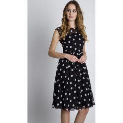 Sukienki balowe: Czarna sukienka w białe groszki BIALCON