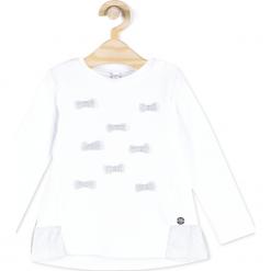 Koszulka. Białe bluzki dziewczęce bawełniane ELEGANT BABY GIRL, z falbankami, z długim rękawem. Za 39,90 zł.
