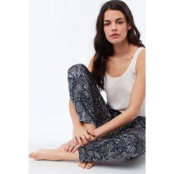 Etam - Spodnie piżamowe Selly. Niebieskie piżamy damskie marki Etam, l, z bawełny. Za 119,90 zł.