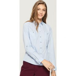 Klasyczna koszula - Niebieski. Niebieskie koszule damskie marki Sinsay, l, klasyczne, z klasycznym kołnierzykiem. W wyprzedaży za 29,99 zł.