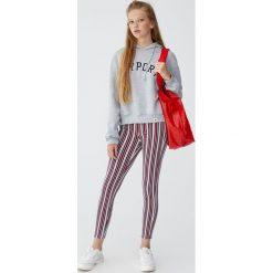 Bluza z kapturem i haftem. Czerwone bluzy męskie rozpinane marki KALENJI, m, z elastanu, z długim rękawem, długie. Za 99,90 zł.
