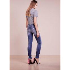 Emporio Armani Jeans Skinny Fit blue denim. Niebieskie jeansy damskie marki Emporio Armani, z bawełny. W wyprzedaży za 1007,20 zł.