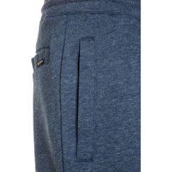 Billabong ALL DAY  Spodnie treningowe dark blue. Niebieskie spodnie chłopięce marki Billabong, z bawełny. Za 169,00 zł.