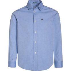 Lacoste Koszula light blue. Szare bluzki dziewczęce bawełniane marki Lacoste. Za 279,00 zł.