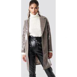 NA-KD Trend Płaszcz w kratkę PU - Beige,Multicolor. Białe płaszcze damskie marki NA-KD Trend, z nadrukiem, z jersey, z okrągłym kołnierzem. Za 404,95 zł.