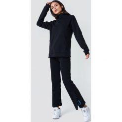 Bluzy rozpinane damskie: NA-KD Urban Bluza z rozcięciami - Black