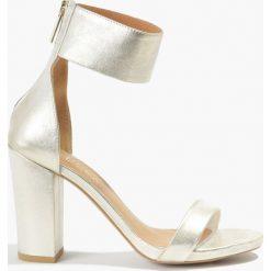Sandały złote. Żółte sandały damskie Badura. Za 151,99 zł.