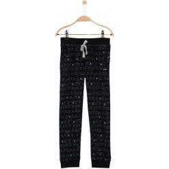 Spodnie dresowe dziewczęce: Spodnie dresowe we wzorzysty deseń dla dziewczynki
