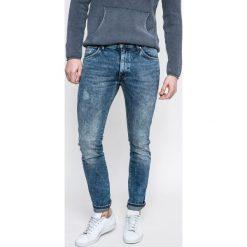 Wrangler - Jeansy Larston BlueE Goods. Niebieskie jeansy męskie z dziurami Wrangler. W wyprzedaży za 239,90 zł.