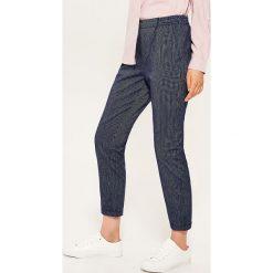 Materiałowe spodnie chino - Granatowy. Niebieskie chinosy damskie House, z materiału. Za 49,99 zł.