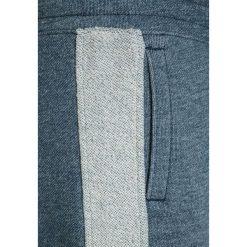 Abercrombie & Fitch SIDE STRIPE  Spodnie treningowe navy. Niebieskie spodnie dresowe dziewczęce Abercrombie & Fitch, z bawełny. W wyprzedaży za 134,25 zł.