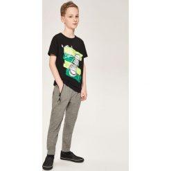 Spodnie dresowe - Szary. Szare chinosy chłopięce Reserved, l, z dresówki. Za 79,99 zł.
