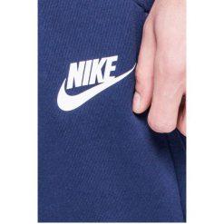 Nike Sportswear - Spodnie. Niebieskie joggery męskie Nike Sportswear, z bawełny. W wyprzedaży za 199,90 zł.