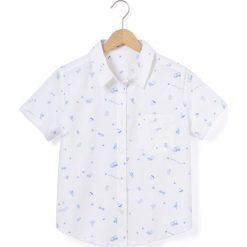 Wzorzysta koszula z kołnierzykiem polo. Białe bluzki dziewczęce z krótkim rękawem La Redoute Collections, z bawełny, z koszulowym kołnierzykiem. Za 48,30 zł.