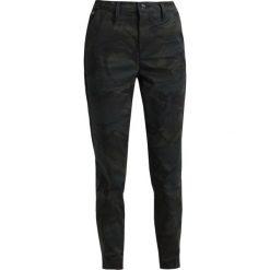 GStar BRONSON BDC MID SKINNY CHINO Spodnie materiałowe asfalt/black. Brązowe chinosy damskie marki G-Star, z bawełny. W wyprzedaży za 375,20 zł.