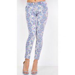 Rurki damskie: Spodnie z motywem w różyczki