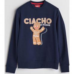 Bluza ze świątecznym nadrukiem - Granatowy. Niebieskie bluzy męskie z nadrukiem marki QUECHUA, m, z elastanu. Za 79,99 zł.