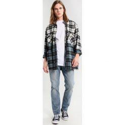 Levi's® 511 SLIM FIT Jeansy Straight Leg rolf warp. Niebieskie jeansy męskie relaxed fit marki Levi's®, z bawełny. Za 399,00 zł.