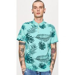 Koszulki polo: Koszulka polo z nadrukiem all over – Turkusowy