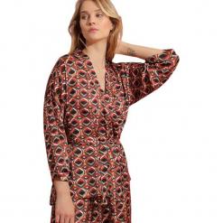 Bluzka w kolorze jasnobrązowym ze wzorem. Brązowe bluzki damskie Almatrichi, s. W wyprzedaży za 179,95 zł.
