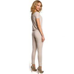JORDAN Elastyczny gładki kombinezon - spodnium z krótkimi rękawami  - beżowy. Brązowe kombinezony damskie Moe, z krótkim rękawem, krótkie. Za 154,90 zł.