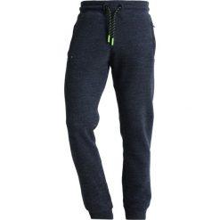 Superdry ORANGE LABEL HYPER POP Spodnie treningowe depths blue grit. Niebieskie spodnie dresowe męskie Superdry, z bawełny. Za 389,00 zł.
